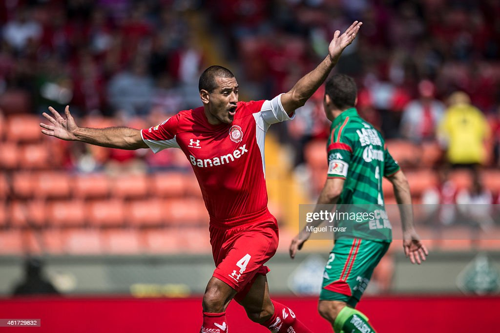 Paulo Da Silva of Toluca celebrates a goal scored by his teammate Isaac Esquivel during a match between Toluca and Chiapas as part of 2nd round Clausura 2015 Liga MX at Nemesio Diez Stadium on January 18, 2015 in Mexico City, Mexico.