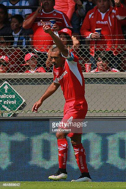 Paulo Da Silva of Toluca celebrates a scored goal during a match between Toluca and Cruz Azul as part of 8th round Clausura 2015 Liga MX at Nemesio...