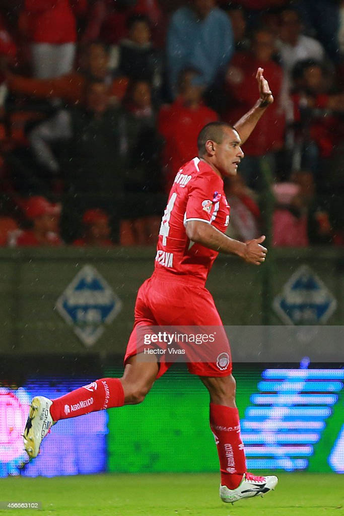 Paulo Da Silva of Toluca celebrates after scoring the first goal of his team during a match between Toluca and Chivas as part of 11th round Apertura 2014 Liga MX at Nemesio Diez Stadium on October 02, 2014 in Toluca, Mexico.