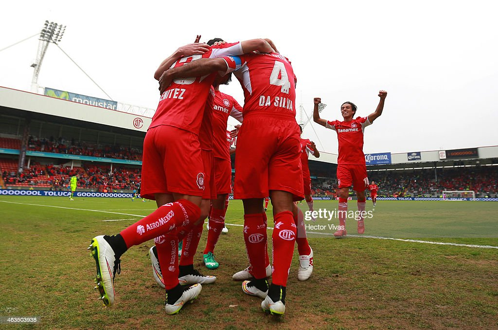 Paulo Da Silva of Toluca celebrates with his teammates after scoring the first goal of his team during a match between Toluca and Santos Laguna as part of 6th round Clausura 2015 Liga MX at Nemesio Diez Stadium on February 15, 2015 in Toluca, Mexico.