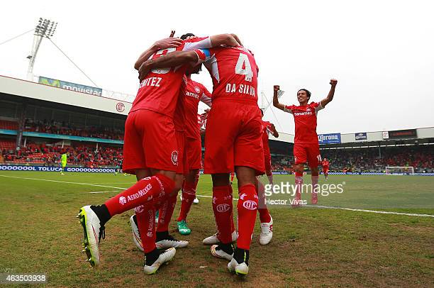 Paulo Da Silva of Toluca celebrates with his teammates after scoring the first goal of his team during a match between Toluca and Santos Laguna as...