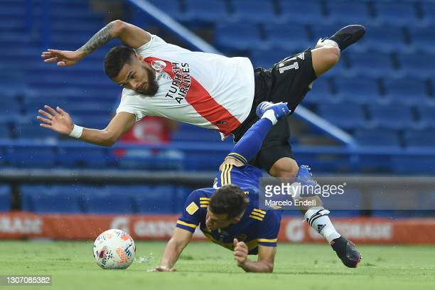 Paulo Díaz of River Plate makes a foul to Nicolás Capaldo of Boca Juniors after which referee sanctions a penalty during a match between Boca Juniors...