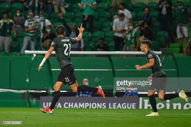 Paulo Dias Fernandes and Ruben Vinagre from Sporting celebrate a goal during the UEFA Champions League group C match between Sporting and Ajax at...