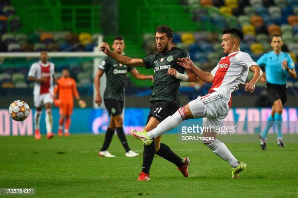 Paulo Dias Fernandes from Sporting and Lisandro Martínez from Ajax in action during the UEFA Champions League group C match between Sporting and Ajax...