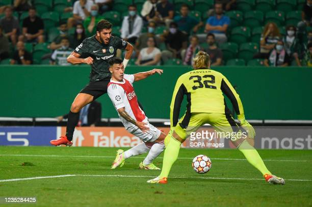 Paulo Dias Fernandes from Sporting , Lisandro Martínez from Ajax and Remko Pasveer from Ajax in action during the UEFA Champions League group C match...