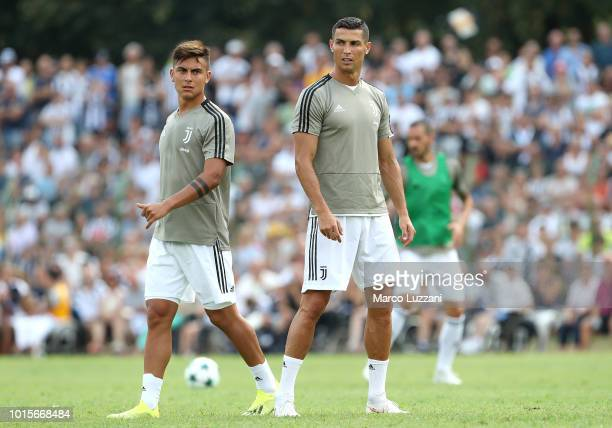 Paulo Dybala and Cristiano Ronaldo of Juventus during the warm up prior to the PreSeason Friendly match between Juventus and Juventus U19 on August...