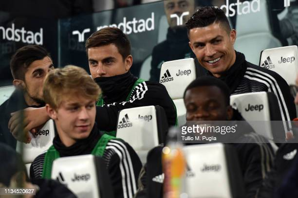 Paulo Dybala and Cristiano Ronaldo of Juventus look on in the bench before the Serie A match between Juventus and Udinese at Allianz Stadium on March...
