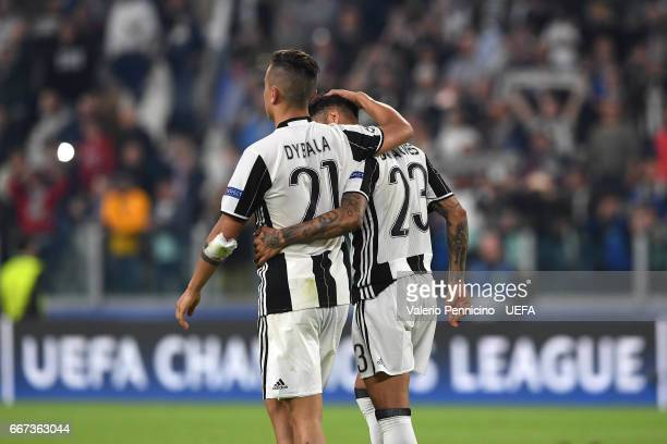 Paulo Dybala and Daniel Alves of Juventus celebrate victory at the end of the UEFA Champions League Quarter Final first leg match between Juventus...