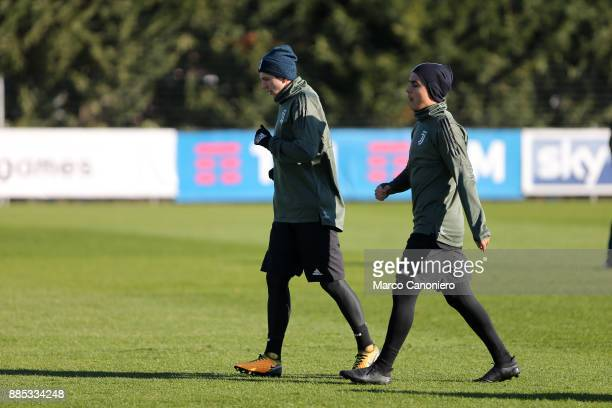 Paulo Dybala and Federico Bernardeschi of Juventus FC during the Juventus FC training on the eve of the UEFA Champions League football match between...