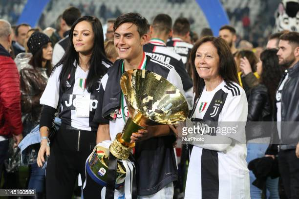 Paulo Dybala and his family with the trophy of Scudetto during the victory ceremony following the Italian Serie A last football match of the season...