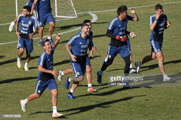 Paulo Dybala and Mauro Icardi of Argentina joke during a training session ahead of the international friendly match against Mexico on November 18...