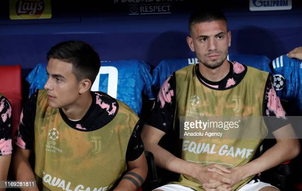 Paulo Dybala and Merih Demiral of Juventus are seen at the bench during UEFA Champions League Group D match between Atletico Madrid and Juventus at...
