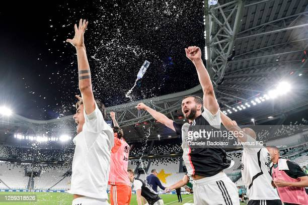 Paulo Dybala and Miralem Pjanic of Juventus celebrate after winning the Serie A championship match between Juventus and UC Sampdoria at Allianz...