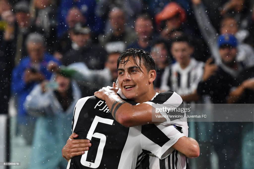 Paulo Dybala and Miralem Pjanic of Juventus celebrate the goal during the Serie A match between Juventus and AC Chievo Verona on September 9, 2017 in Turin, Italy.
