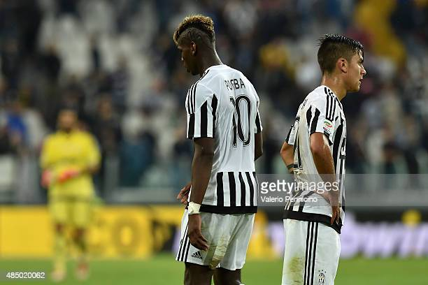 Paulo Dybala and Paul Pogba of Juventus FC look dejected at the end of the Serie A match between Juventus FC and Udinese Calcio at Juventus Arena on...