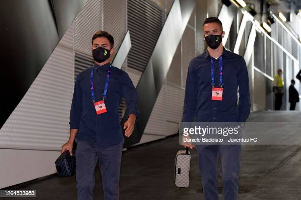 Paulo Dybala and Rodrigo Bentancur of Juventus arrive at the stadium prior to the UEFA Champions League round of 16 second leg match between Juventus...