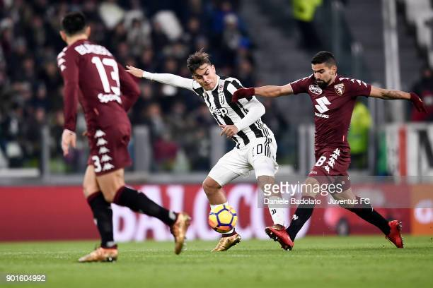 Paulo Dybala and Tomas Rincon during the TIM Cup match between Juventus and Torino FC at Allianz Stadium on January 3 20