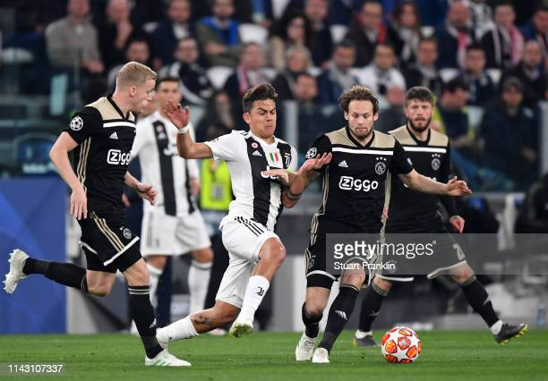 Paulo Dybala Captain of Juventus tackles Daley Blind of Ajax during the UEFA Champions League Quarter Final second leg match between Juventus and...