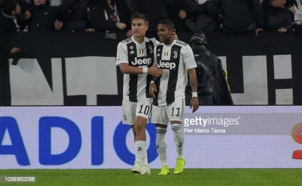 Paulo Dybala celebrates his first goal with Douglas Costa during the Serie A match between Juventus and Cagliari on November 3 2018 in Turin Italy