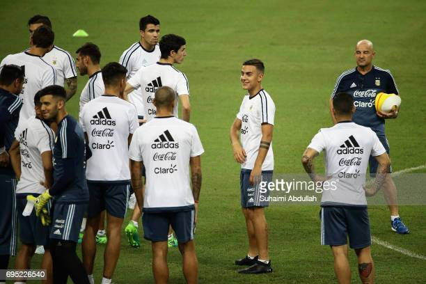 Paulo Dybala chats with teammates during an Argentina training session at National Stadium on June 12 2017 in Singapore Argentina is scheduled to...
