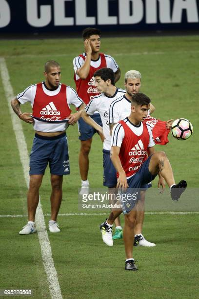 Paulo Dybala controls the ball during an Argentina training session at National Stadium on June 12 2017 in Singapore Argentina is scheduled to play...