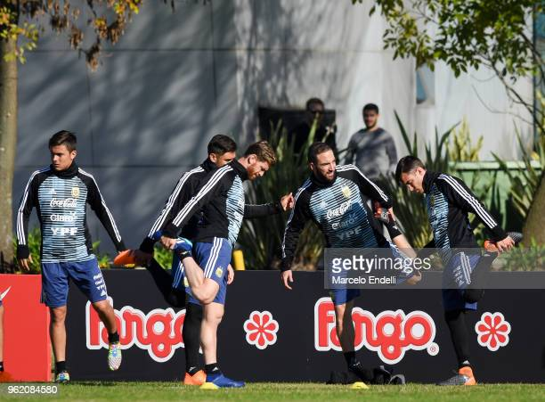 Paulo Dybala Cristian Ansaldi Gonzalo Higuain and Nicolas Tagliafico of Argentina stretch during a training sessionn as part of the preparation to...