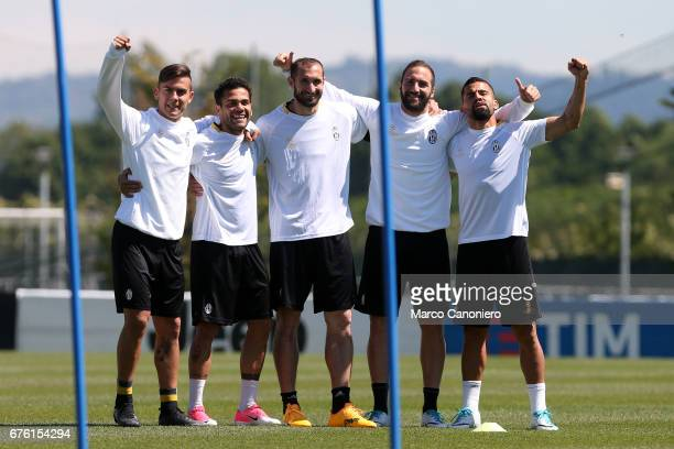 Paulo Dybala Dani Alves Giorgio Chiellini Gonzalo Higuain and Tomas Rincon of Juventus FC during the Juventus FC training on the eve of the UEFA...