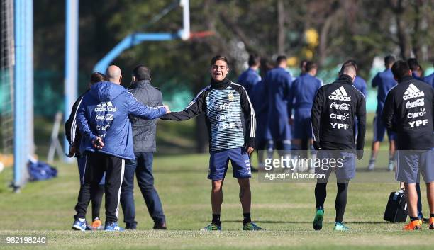 Paulo Dybala greets assistant coach Jorge Desio before a training session as part of the preparation to FIFA Russia 2018 on May 23 2018 in Buenos...