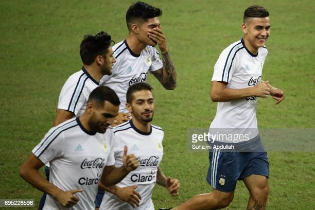 Paulo Dybala jogs with teammates during an Argentina training session at National Stadium on June 12 2017 in Singapore Argentina is scheduled to play...