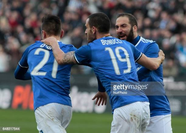 Paulo Dybala Leonardo Bonucci and Gonzalo Higuain during Serie A match between Udinese v Juventus in Udine on March 25 2017