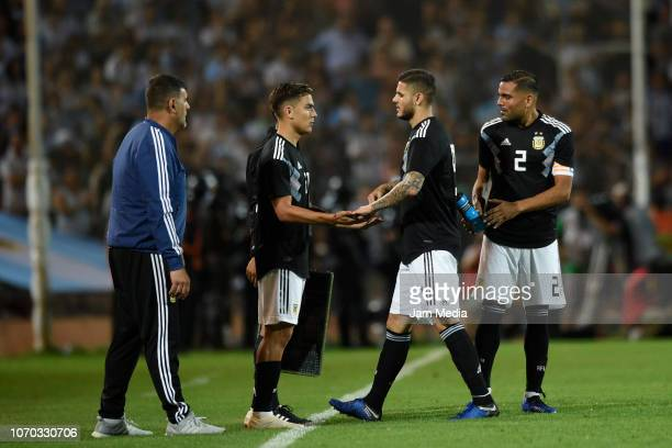 Paulo Dybala Mauro Icardi and Gabriel Mercado of Argentina look on during a friendly match between Argentina and Mexico at Malvinas Argentinas...