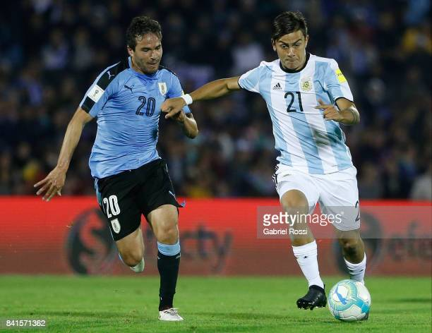 Paulo Dybala of Argentina Alvaro Gonzalez of Uruguay fight for the ball during a match between Uruguay and Argentina as part of FIFA 2018 World Cup...
