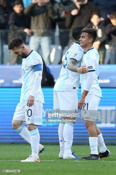 Paulo Dybala of Argentina celebrates after scoring the second goal of his team with teammates Leandro Paredes and Lionel Messi during the Copa...