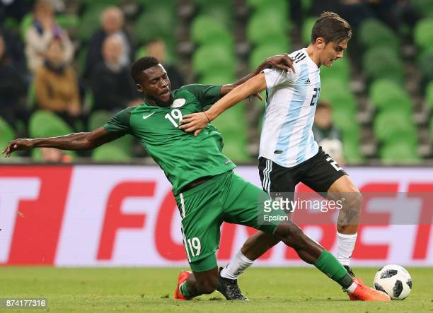 Paulo Dybala of Argentina competes for the ball with John Ogu of Nigeria during an international friendly match between Argentina and Nigeria at...