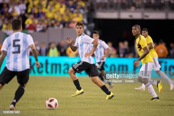 Paulo Dybala of Argentina defended by Wilmar Barrios of Colombia during the Argentina Vs Colombia International Friendly football match at MetLife...
