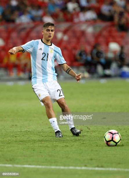 Paulo Dybala of Argentina dribbles the ball during the international friendly match between Argentina and Singapore at National Stadium on June 13...
