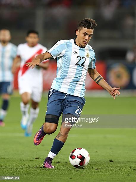 Paulo Dybala of Argentina drives the ball during a match between Peru and Argentina as part of FIFA 2018 World Cup Qualifiers at Nacional Stadium on...
