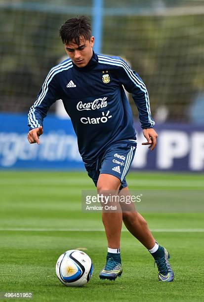 Paulo Dybala of Argentina drives the ball during a training session at Argentine Football Association 'Julio Humberto Grondona' training camp on...