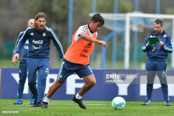 Paulo Dybala of Argentina drives the ball during a training session at 'Julio Humberto Grondona' training camp on August 28 2017 in Ezeiza Argentina