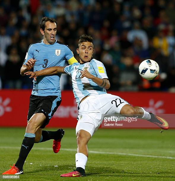 Paulo Dybala of Argentina fights for the ball with Diego Godin of Uruguay during a match between Argentina and Uruguay as part of FIFA 2018 World Cup...