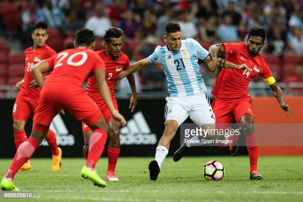 Paulo Dybala of Argentina fights for the ball with Hariss Harun of Singapure during the International Test match between Argentina and Singapore at...