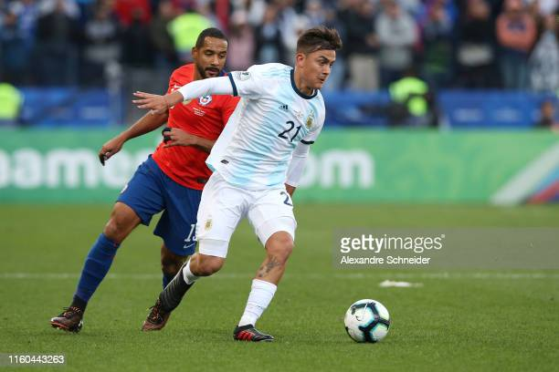 Paulo Dybala of Argentina fights for the ball with Jean Beausejour of Chile during the Copa America Brazil 2019 Third Place match between Argentina...