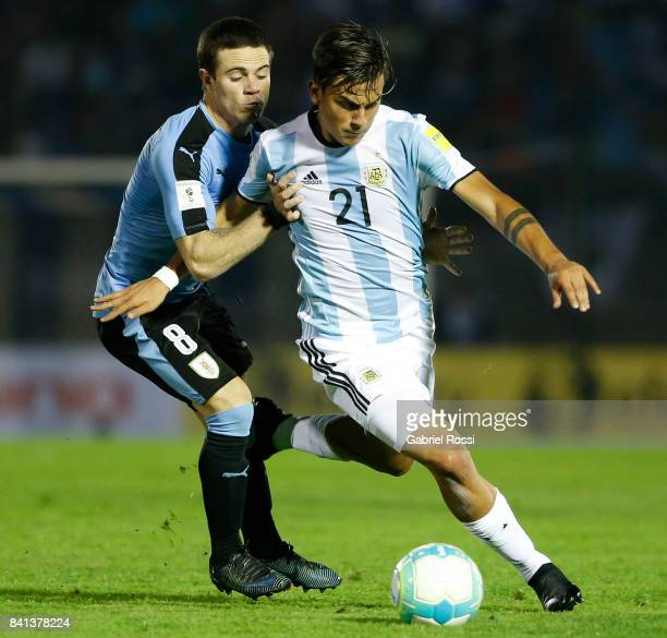 Paulo Dybala of Argentina fights for the ball with Nahitan Nandez of Uruguay during a match between Uruguay and Argentina as part of FIFA 2018 World...