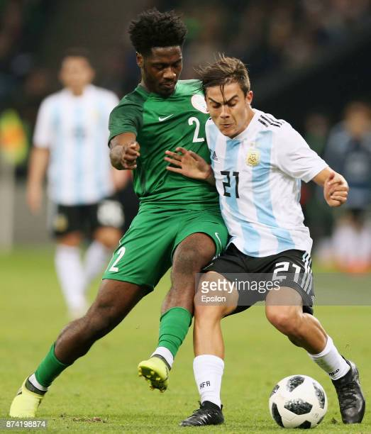 Paulo Dybala of Argentina fights for the ball with Ola Aina of Nigeria during an international friendly match between Argentina and Nigeria at...