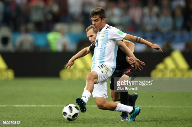 Paulo Dybala of Argentina holds off Andrej Kramaric of Croatia during the 2018 FIFA World Cup Russia group D match between Argentina and Croatia at...