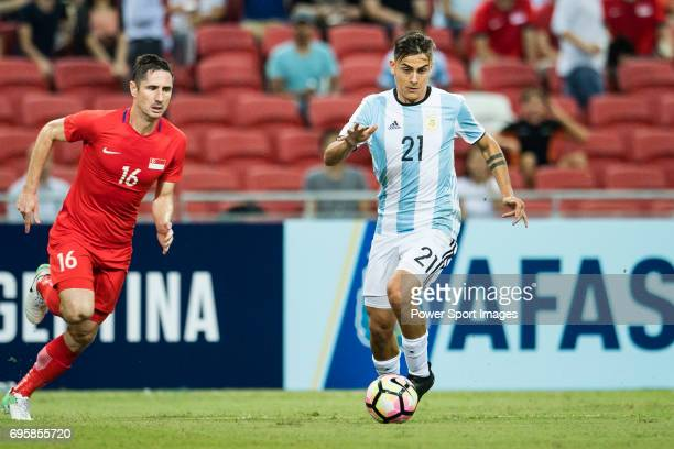 Paulo Dybala of Argentina in action against Daniel Bannett of Singapore during the International Test match between Argentina and Singapore at...