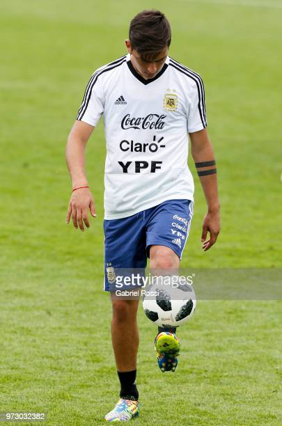 Paulo Dybala of Argentina kicks the ball during a training session at the team base camp on June 13 2018 in Bronnitsy Russia