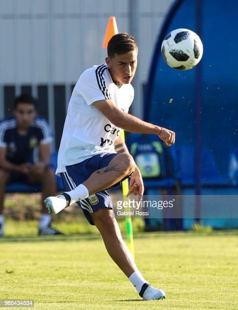 Paulo Dybala of Argentina kicks the ball during a training session at Stadium of Syroyezhkin sports school on June 27 2018 in Bronnitsy Russia