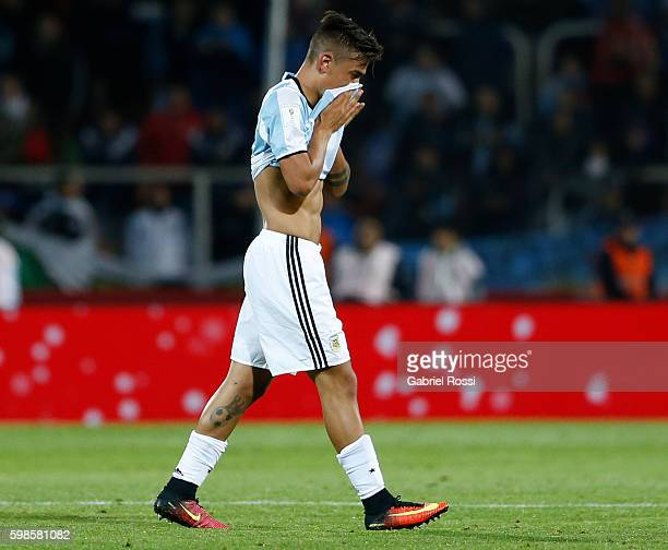 Paulo Dybala of Argentina leaves the field after receiving the red card during a match between Argentina and Uruguay as part of FIFA 2018 World Cup...