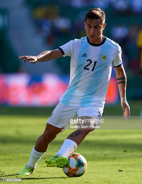 Paulo Dybala of Argentina runs with the ball during the international friendly match between Ecuador and Argentina at Estadio Manuel Martinez Valero...